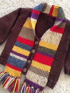 Knitting pattern for a Doctor Who baby sweater! Scarf is built right into the sweater! ADORABLE.