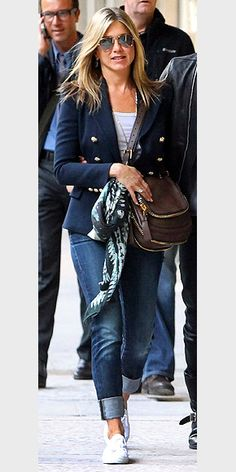 This is so simple, a tank, jeans, simple but luxe bag, then throw a crisp blazer and chic scarf to throw it all together. Change the shades sneakers to add further polish.