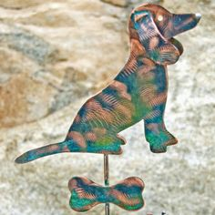 This precious Dachshund is sitting  waiting for you! This beautiful dog  garden stake is accented artistic copper wire wrapping, flower, butterfly and heart soldered to a solid copper rod.  View listing to see full description. Thank you for visiting.