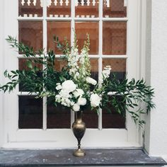 Chic Floral Arrangement by #PeplumEvents. White and green floral in antique brass vase.