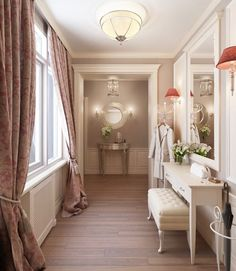 This two bedroom apartment is located in St. Petersburg. The drawing hall has combined the elegance of a study with the charm of traditional furniture including an enticing fire place. The accessories used add to its austere tone. The dining hall is really spacious and the perfect selection as well as arrangement of the furniture makes it look even wider.