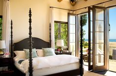 Bedroom with doors on the beach. Spanish Colonial in Malibu.