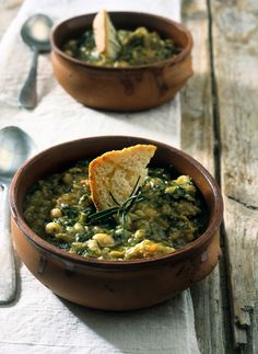 """Ribollita is a famous Tuscan soup, a hearty potage made with bread and vegetables. There are many variations but the main ingredients always include leftover bread, cannellini beans and inexpensive vegetables such as carrot, cabbage, beans, silverbeet, cavolo nero, and onion. Its name literally means """"reboiled"""". Like most Tuscan cuisine, the soup has peasant origins. It was originally made by reheating (i.e. reboiling) the leftover minestrone or vegetable soup from the previous day."""