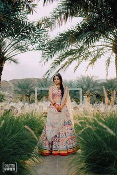 Destination wedding in Fujairah with bride in orange Sabyasachi lehenga Wedding Goals, Destination Wedding, Sabyasachi Collection, Haldi Ceremony, Bollywood Girls, Bride Look, White Bridal, Mehendi, Beautiful Bride
