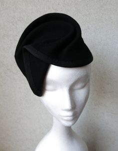 Celia, a sculptural black wool felt hat with pleats and folds.  Wired and trimmed with Mokuba moire grosgrain ribbon.  By Mikado Millinery.