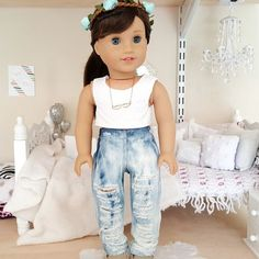 18 inch doll distressed jeans.  shirt, shoes and accessories not included. *** jeans are distressed by hand, distressing and color varies for each pair*** **rips in jeans may cause difficulties for small children to put on doll**