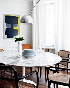 Dining Room With Marble Tulip Table and Cane Chairs
