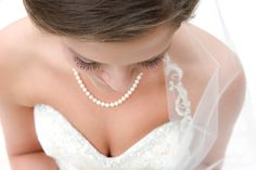 This bridal image has a very flattering angle! We love unique photos from Elizabeth Looney Photography! Click the image to get Elizabeths contact information!