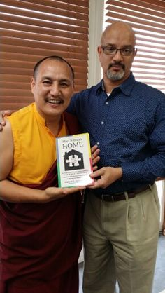 Presenting Lama Tenzin with a copy of When Nobody's Home.