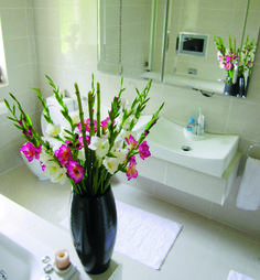 Milan Planter finished off beautifully with flowers in the bathroom http://www.livingreendesign.com/category/55-milan.aspx