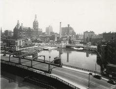 A look toward downtown Milwaukee south down the Milwaukee River. City Hall is in the distance on the left.Photo taken around 1930.