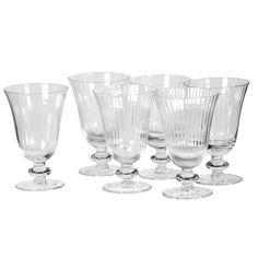 Finely ribbed clear glass wine goblets or glasses