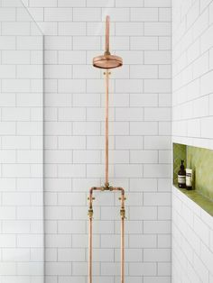 Exposed Copper Pipes Shower head, white subway tile with dark grout, and green Moroccan tile in a niche. Bathroom Renos, Small Bathroom, Master Bathroom, Copper Bathroom, Washroom, Bathroom Green, Bathroom Vanities, Bathroom Fixtures, White Bathroom