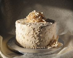 Roses and Lace  By: SherylB -   This anniversary cake is chocolate cake with chocolate ganache, caramel, and pecan (turtle) filling. The design mimics the wedding cake I made for the couple last year, and the lace pattern copies the lace in her wedding dress.