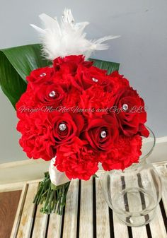 Red rose, carnations, and rhinestone bridal bouquet by Forget-Me-Not Flowers and Gifts