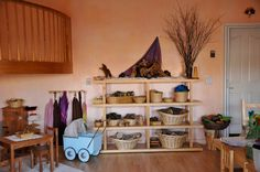 Our physical space is so important to grounding in our first chakra. Natural play things and order make all the difference between providing a grounded play space for your child. Montessori, Waldorf Playroom, Natural Shelves, Natural Play Spaces, Preschool Rooms, Home Daycare, Basket Shelves, Learning Spaces, Classroom Inspiration