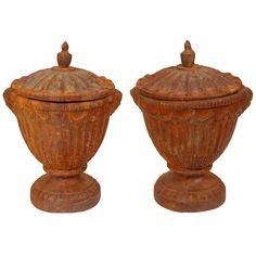 Pair of Vintage Iron Urns   From a unique collection of antique and modern urns at https://www.1stdibs.com/furniture/building-garden/urns/