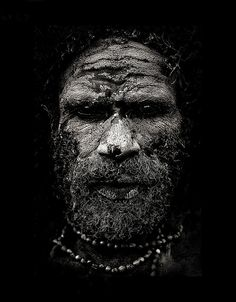 Chimbu Papuan man, covered with mud - Papua New Guinea    Eglu Narko, from Chimbu men tribe. With mud on his face to celebrate a death. - Papua New Guinea , Highlands, Mount Hagen festival singsing    © Eric Lafforgue   www.ericlafforgue.com