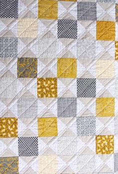 This is nice. Alternating neutral Hourglass blocks with colored solids.