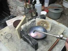 This is preparation to setting the base,  annealing to let the work hardened metal relax in to a malleable state and then marking for two different types of vessel.  The actual setting of the base is in part 3. If you were using the angular raising method the vessel would already have a rudimentary base, setting it as sharply as we will in part ...
