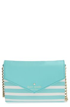 Will be ready for whatever the day—or evening—brings with this turquoise and cream Kate Spade crossbody bag.