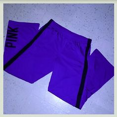 Victoria's Secret PINK track pants Very gently used vs PINK track pants. They have a drawstring inside waist band to adjust and zips on both leg bottoms. PINK emblem on right leg and under the front left pocket. Great for working out or running! Excellent condition. Size Medium. These are actually a darker blue/purple but the flash made them look lighter. Make an offer!!!  PINK Victoria's Secret Pants Track Pants & Joggers