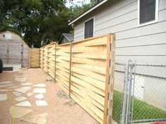well, that's a darn cool fence. who knew I'd be looking at fences on the internet on a Monday night?