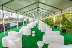 Kehoe Designs used white plastic lounge furniture on the deck of Lollapalooza's V.I.P. area in 2014; this year, the firm will debut new wicker furniture rentals.