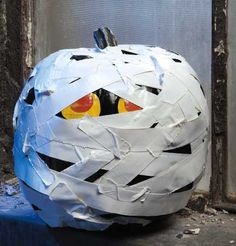 Love the Mummy Pumpkin from the new Leisure Arts Stick or Treat pattern book & Duck brand duct tape!