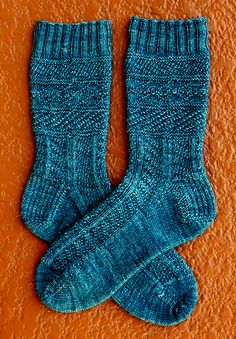 Ravelry: Moody Stockings - SKA November Mystery Sock pattern by Erica Lueder. I really like the linear stitch design in the bottom of these socks. I think I'd mod these to continue that pattern up to the cuff and opt out of the rest Crochet Socks, Knit Or Crochet, Knitting Socks, Hand Knitting, Knit Socks, Knitted Slippers, Crochet Granny, Knitting Patterns Free, Knit Patterns