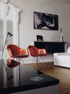 Eames chairs. Nice touch or orange.