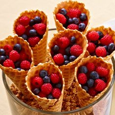 Waffle cones aren't just for ice cream anymore. Fill them with fresh berries and top with yogurt or whipped cream for a fun, healthy snack. And you'll get extra points for presentation. Just fill the Trifle Bowl with your favorite cereal or granola, then arrange the fruit-filled cones with the points down — it doubles as a food-centric centerpiece.