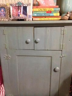 When I bought this little jelly cupboard, it was painted lime green. Cute--but did not match my decor. (Aqua blue, turquoise and shades of brown with pops of orange!). Sooo out comes my Annie Sloan chalk paint in Duck Egg. It was perfect!!  Finished it with light and dark wax. It had a soft sheen and looks great in my bedroom.