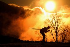 A biathlete practices ahead of the Sochi 2014 Winter Olympics at the Laura Cross-Country Ski and Biathlon Center on February 5, 2014. (Julian Finney/Getty Images)
