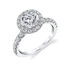 """This beautiful halo round engagement ring features a bold 0.91 carats of glistening diamonds flowing down each side of the thick shank and within the halo surrounding its 1.5 carat round brilliant center. Beautifully crafted to be able to customize with any shape or size of center stone, this daring halo ring is truly a show stopper she will say """"YES"""" to! Pair it with its matching thick engagement ring band, BS1960 to create the ultimate glamorous halo wedding ring set. Sylvie Collection Perfect Engagement Ring, Band Engagement Ring, Engagement Ring Settings, Diamond Bands, Halo Diamond, Halo Setting, Halo Rings, Round Diamonds, Wedding Rings"""
