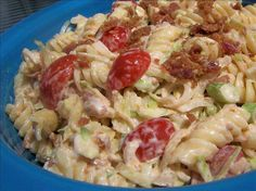 BLT Macaroni Salad -     This cold salad is the best I have ever made. It will fly right off of the table.   1/2 cup mayonnaise  3 tablespoons chili sauce  2 tablespoons lemon juice  1 teaspoon sugar  3 cups elbow macaroni, cooked  1/2 cup tomato, seeded and chopped  2 tablespoons green onions, chopped  3 cups lettuce, shredded  4 slices cooked bacon, crumbled   Directions: 1. In a large bowl, combine the first four ingredients; mix well. 2. Add the macaroni, tomato and onions; toss to coat…