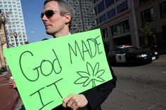 A medical marijuana activist holds a sign during a rally Jan. 4, 2010, in Oakland, Calif. Research suggests marijuana may fight cancer itsel...