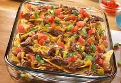 Tortilla chips are topped with shredded beef, pinto beans and Cheddar cheese for tasty nachos everyone will enjoy. Plus, you can have this easy appetizer ready to serve in just 25 minutes.