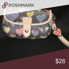 Dooney & Bourke Wristlet In excellent condition  One large compartment on the inside   Black wristlet with tan linings and pink, yellow, purple, orange, hearts Dooney & Bourke Bags Clutches & Wristlets