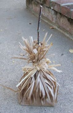 Paper Bag Broom...party table decor.  Maybe sprinkle some leaves around it to make it look like sweeping away leaves.