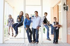 The pupplies are cool, but what I really like is the staggered heights and stances.   via 6 Common Mistakes When Posing Families   SLR Lounge