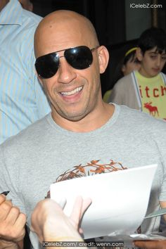 Vin Diesel Vin Diesel signs autographs for fans as he leaves the Corinthia Hotel http://icelebz.com/events/vin_diesel_signs_autographs_for_fans_as_he_leaves_the_corinthia_hotel/photo1.html