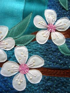 close up by the blue hare, via Flickr - gives me a great idea to make a quilt from a blue parrot design I did in ceramics