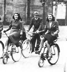 Original Velocino Bikes. Notice women in dresses can ride them. The handlebars go underneath instead of right in front of the knees.