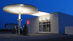 Arne Jacobsen, Texaco Skovshoved Petrol Station, near Copenhagen, Denmark. Designed in drawing by Jacobsen. It was reconstructed in The shape of the roof is referring to the Ant chair. Arne Jacobsen, Louisiana, Ant Chair, Pompe A Essence, Walter Gropius, Filling Station, Famous Architects, Charles Eames, Copenhagen Denmark