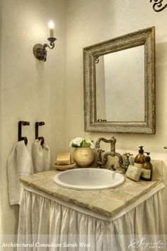 Perfection...Love the towel bars and skirted vanity.