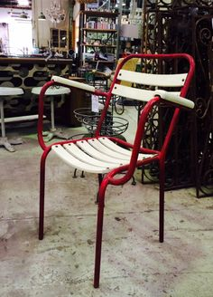 Outdoor / Indoor Metal French Stackable Carver painted red. Original European Panels in the background. All available at Le Forge 59 Denison Street,  Camperdown NSW Australia www.leforge.com.au