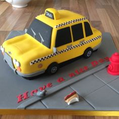In the City themed party taxi cab cake