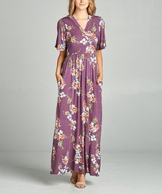 Long and flowing, this maxi dress boasts a popping floral print and eye-catching surplice neckline.