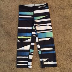 Nike Capri Tights Nike Pro Core Sublimated Women's  Capri Tights. Lightweight and contoured these are an ideal base layer with enough substance to be worn as a outer layer. EUC Nike Pants Track Pants & Joggers